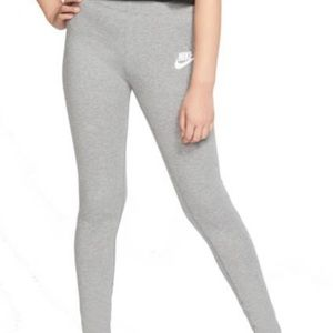 light gray Nike leggings with Nike swish